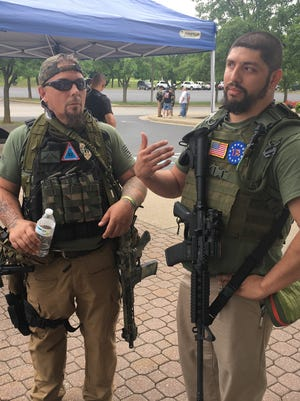 "Pictured are two men who joined Saturday's rally at the Augusta County Government Center in Verona in support of the ""Ghost Squad."" Both men declined to be identified."