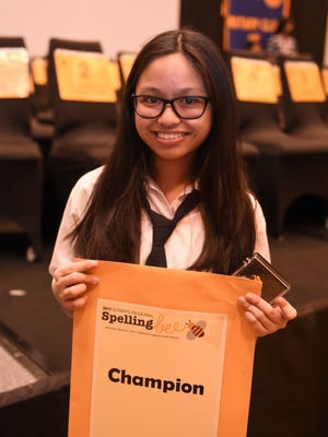 Saint Anthony Catholic School eighth grader Alyssa Dela Cruz poses for a photo after winning the 45th Annual Scripps Regional Spelling Bee Competition at Sheraton Laguna Guam Resort in Tamuning on March 4, 2017.