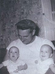 Joseph Carr Sr. holds his twins, Lisa Carr and Joseph Carr Jr.