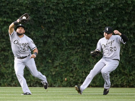 Chicago White Sox left fielder Melky Cabrera (53) catches a fly ball from Chicago Cubs' Anthony Rizzo as center fielder J.B. Shuck avoids a collision during the third inning of a baseball game Thursday, July 28, 2016, in Chicago. (AP Photo/Charles Rex Arbogast)