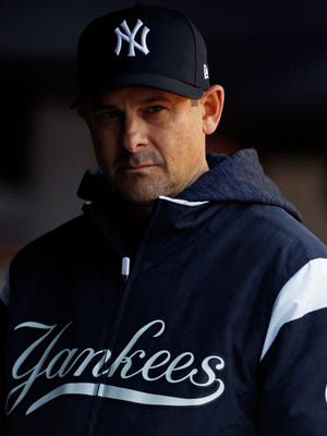 Apr 7, 2018; Bronx, NY, USA; New York Yankees manager Aaron Boone (17) looks on against the Baltimore Orioles during the fifth inning at Yankee Stadium.