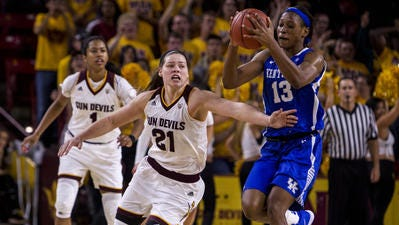 Sophie Brunner (21) tries for a steal in ASU's 68-64 overtime loss to Kentucky. The Sun Devils dropped three sports to No. 18 in the AP top 25 after the loss.