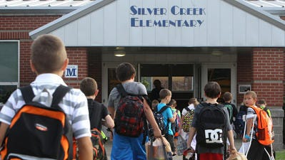 Students enter Silver Creek Elementary on the first day of the 2015-16 school year.