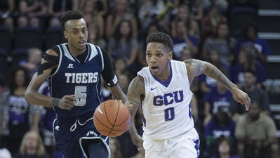 Grand Canyon senior point guard DeWayne Russell could hand the ball off  to his brother Daron, a top senior high school point guard in Philadelphia, next year if the younger Russell commits there.