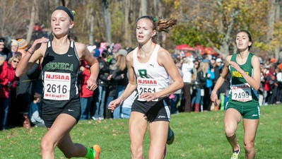 Ridge's Catherine Giuseffi (center) competes at the Meet of Champions on Nov. 21, 2015.