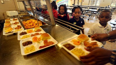 Students pick up lunch in a Lafayette Parish school.