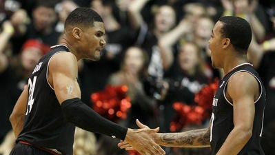 University of Cincinnati players Kyle Washington (left) and Troy Caupain (right)  both were named second team All-American Athletic Conference on Tuesday.