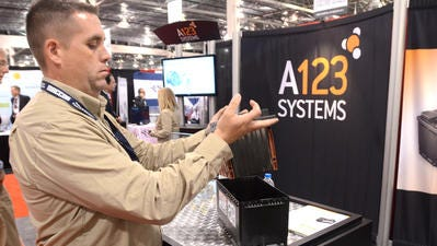 Sean Bartolucci puts away a sample battery pack from A123 Systems at the 2015 International Battery Show at Novi's Suburban Collection Showplace in this file photo. A123 Systems announced Monday it would move its headquarters from Livonia to Novi.