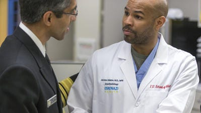 Dr. Jerome Adams meets with the previous surgeon general, Dr. Vivek Murthy.