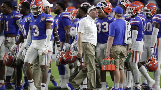 Under the direction of Florida head coach Dan Mullen (center), the Gators are set to open preseason camp today and have been participating in on-campus workouts voluntarily since the start of June.