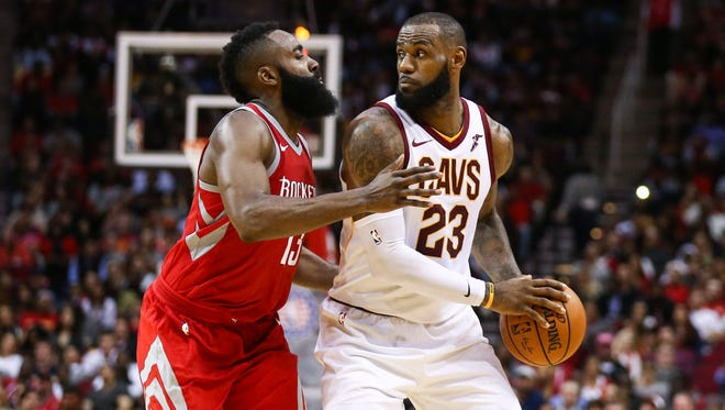 Cleveland Cavaliers forward LeBron James (23) dribbles the ball as Houston Rockets guard James Harden (13) defends during the game at Toyota Center.
