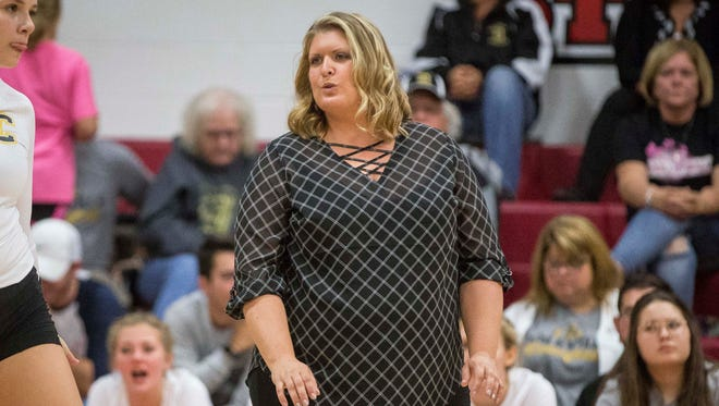 Whitney Stewart, shown here coaching Cowan in the Delaware County Tournament, is returning to Delta as its head volleyball coach.