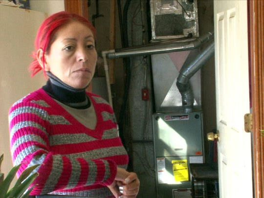 Marisol Hernandez is shown in the Lakewood home she rents with her family and 11 other people.