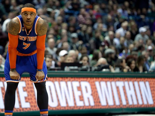 FILE - In this March 8 2017, file photo, New York Knicks' Carmelo Anthony watches a free throw during the second half of an NBA basketball game against the Milwaukee Bucks in Milwaukee. The Knicks agreed to trade Anthony to the Thunder on Saturday, Sept. 23, 2017, saving themselves a potentially awkward reunion next week with the player they'd been trying to deal since last season.  New York will get Enes Kanter, Doug McDermott and a draft pick, a person with knowledge of the deal said. The person spoke with The Associated Press on condition of anonymity because the trade had not been announced.
