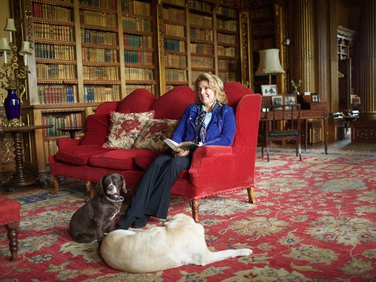 Lady Carnarvon, Countess of Highclere Castle, with two of the castle's canine family.