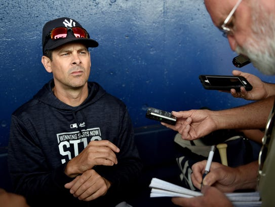 New York Yankees manager Aaron Boone (17) fields questions