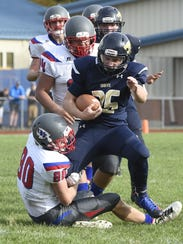 Owego's Beckett Hafer tries to hang on to Susquehanna