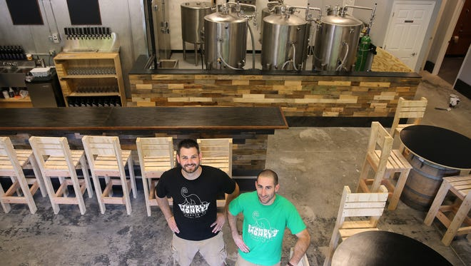 Rob Shafer (L) and Eric Miller are co-owners of Stumblin' Monkey Brewery in Victor.