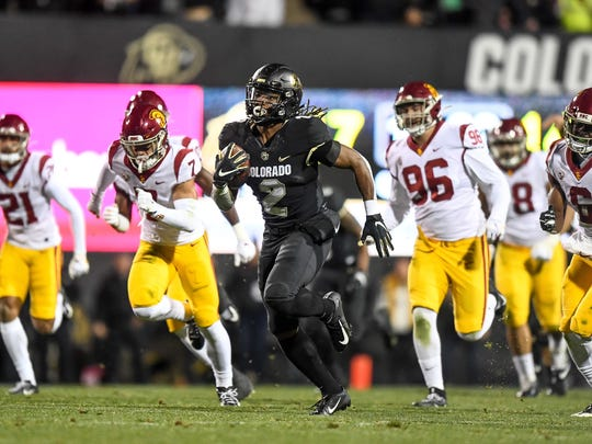 Laviska Shenault Jr. #2 of the Colorado Buffaloes carries the ball for a 73-yard touchdown catch against the USC Trojans in the third quarter of a game at Folsom Field on October 25, 2019 in Boulder, Colorado.