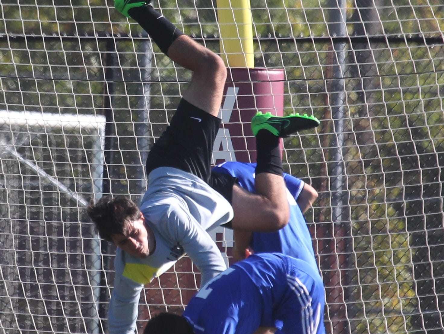 Lakeland goalie Aaron Kreuter is upended as he makes a save against Goshen during their Section 1 vs. Section 9 Challenge game at Valhalla Oct. 12, 2015. Goshen won 2-1 in overtime.