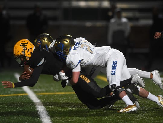 Reed's Chase Merrill (21) gets a tackle against Bishop