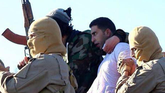 A still image released by the Islamic State group's branch in Raqqa on jihadist websites on Dec. 24, 2014, purportedly shows a Jordanian pilot captured by the group's fighters.