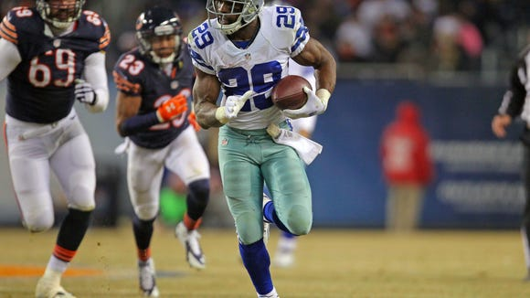 Dec 4, 2014; Chicago, IL, USA; Dallas Cowboys running back DeMarco Murray (29) runs with the ball during the second half against the Chicago Bears at Soldier Field. Dallas won 41-28.