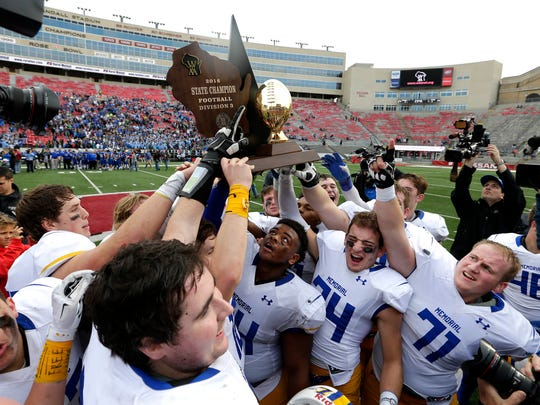 Catholic Memorial team members celebrate their 24-14 win over Notre Dame de la Baie Academy's to claim the Division 3  2016 WIAA State football championship at Camp Randall Stadium in Madison, Wisconsin, Friday, November 18, 2016.