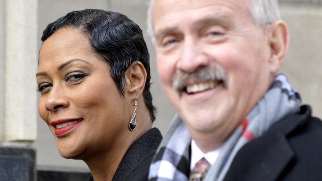 Monica Morgan-Holiefield walks into the federal court building with her attorney, Steve Fishman, before pleading guilty to a tax crime but blamed others for a $1.5 million corruption.