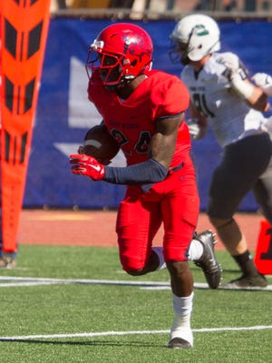 Former DSU corner Tyneil Cooper runs with the ball during a game against Adams State on Oct. 28, 2017.