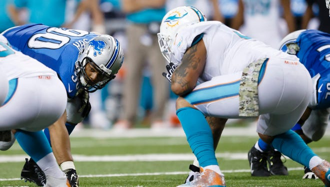 Detroit Lions defensive tackle Ndamukong Suh (90) gets set against the Miami Dolphins on Nov. 9, 2014.