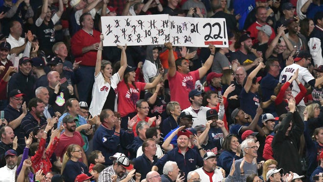 Indians fans unfurl a banner marking their 22nd consecutive victory on Thursday night at Progressive Field.