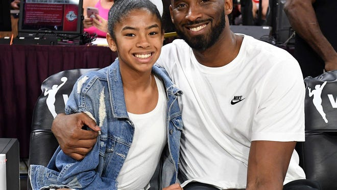 LAS VEGAS -- Gianna Bryant and her father, former NBA player Kobe Bryant, attend the WNBA All-Star Game 2019 at the Mandalay Bay Events Center last July.