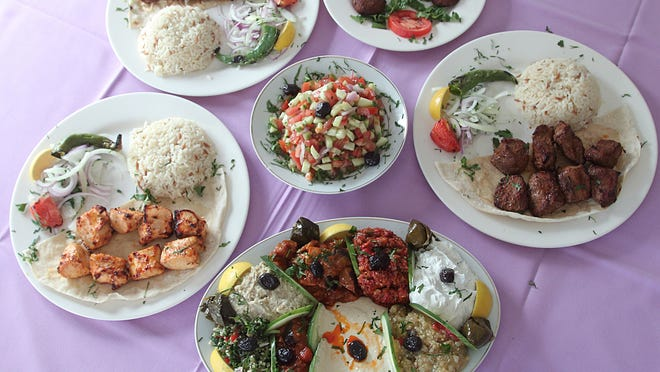 Cuisine served up the Mor Turkish Restaurant in Madison  (clockwise, from  bottom) A plate of mixed appetizers, Chicken Kebab, Adana Kebab, Falafel, Shish Kebab, and  Shepherd Salad, center.