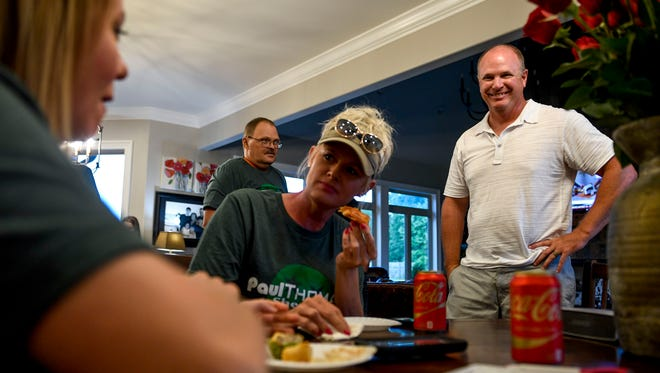 Gibson County Sheriff Paul Thomas smiles and Jennifer Quertermous, center, leans in and April Thomas, left, gets ready to write down numbers while listening to the radio station announcing vote counts that had Thomas ahead at 1065 Pleasant Cove in Milan, Tenn., Thursday, Aug. 2, 2018.