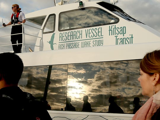 Rich Passage 1 Capt. Aren Jensen watches passengers line up to board the Rich Passage I early Monday in Bremerton. The 118-passenger ferry sailed at 55 percent capacity for all runs Monday and Tuesday morning, but commuter runs (toward Seattle in the morning, toward Bremerton at night) were at 83 percent.