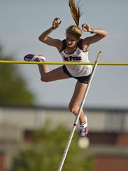 De Pere's Kylie Swiekatowski clears the bar while competing