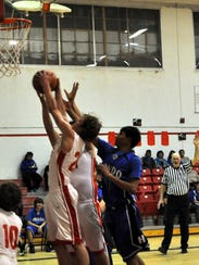Corona's Sam Brown attempts a layup while being pressured