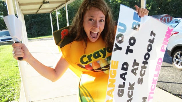 Maryville Elementary School Counselor Kaet Barron dressed like a box of crayons to greet students on the first day of school. Barron was recently named Elementary School Counselor of the Year by the Kentucky School Counselors Association.