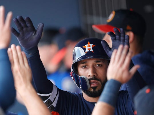 Houston Astros left fielder Marwin Gonzalez (9) celebrates in the dugout after hitting a home run in the first inning of a spring training baseball game against the Washington Nationals, Tuesday, March 6, 2018, in West Palm Beach, Fla. (AP Photo/John Bazemore)