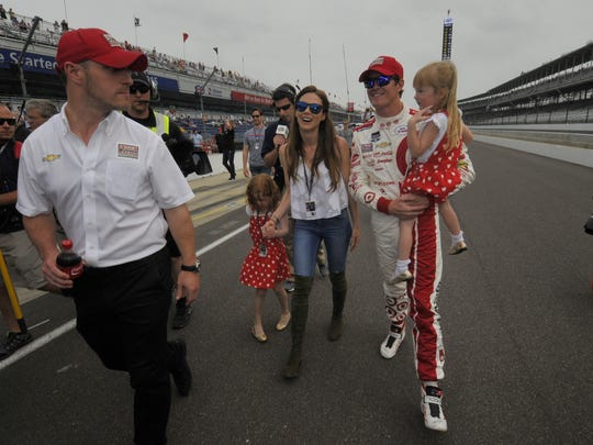 Scott Dixon and his family, wife Emma and daughters Poppy and Tilly, walked down to the yard of bricks to celebrate winning the pole position for the 2015 Indianapolis 500.