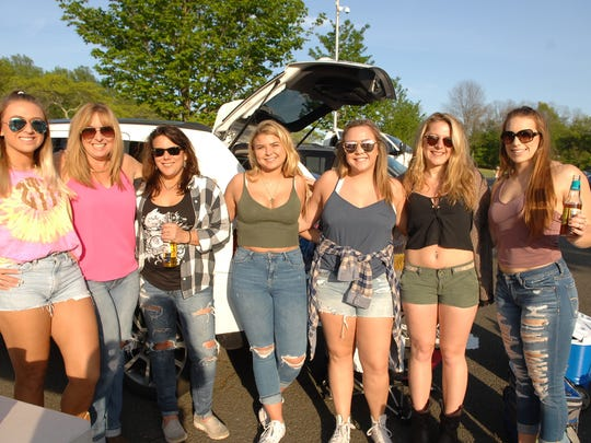 Dierks Bentley opened the concert season at the PNC Bank Arts Center in Holmdel on Thursday night. A group of fans are shown prior to the show.