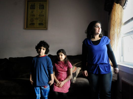Najwa Basuf, a Syrian refugee, now lives with her husband and four children in Clifton. She's photographed on Feb. 14, 2014 with son, Mazen Tadmuri, 6 1/2; and daughter, Razan Tadmuri, 9-years-old, in her Clifton home.