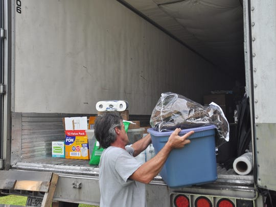 A trustee inmate at the Madison County Jail helps unload