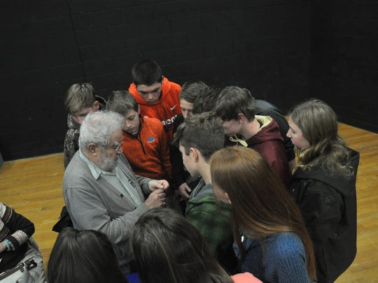 Walter Ziffer, a Holocaust survivor, author and retired professor, showed students the replica of a pendant he received from his first love before she was gunned down alongside her family by German soldiers during World War II.
