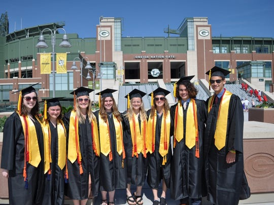 These Plymouth High School summa cum laude graduates participated in the Best of Class event at Lambeau Field.