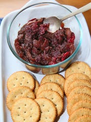 Caramelized onion-cranberry chutney is served with crackers and cream cheese.