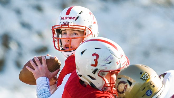 St. John's quarterback Jackson Erdmann looks for an open receiver against Concordia during the first half Saturday, Nov. 11, at Clemens Field.
