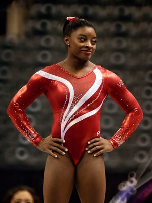 Simone Biles became the first woman to win three consecutive gymnastics world championships.