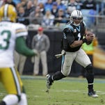 The Carolina Panthers' Cam Newton (1) and Devin Funchess (17) celebrate their touchdown against the Green Bay Packers in the second half of in Charlotte, N.C.
